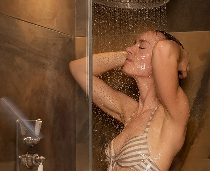 a woman showering in one of Homefield Grange's showers